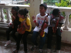 Our children from the Aldona Project wait to have their instruments tuned